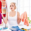 Woman trying to choose clothes to dress — Stock Photo #45400511