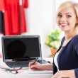 Woman sitting at her working place — Stock Photo
