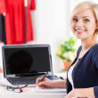 Woman sitting at her working place — Stock Photo #45400595