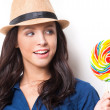Woman looking at big lollipop — Stock Photo #45466547