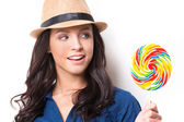 Woman looking at big lollipop — Stock Photo