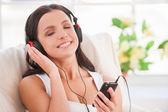 Woman in headphones — Stock Photo