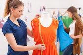 Designer measuring dress. — Stock Photo