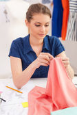 Confident tailor sewing. — Stock Photo