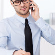 Man in shirt and tie talking on phone — Stock Photo