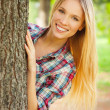 Woman looking out of the tree — Stock Photo