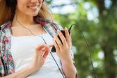 Enjoying favorite music outdoors. — Stock Photo