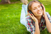 Enjoying favorite music in nature. — Stock Photo