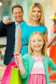 Family holding shopping bags — Stock Photo