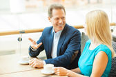 Couple drinking coffee in coffee shop — Stock Photo