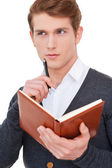 Man holding note pad — Stock Photo