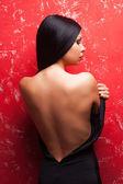 Woman taking off her dress — Stockfoto