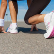 Woman in sports shoes standing in starting line — Stock Photo