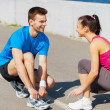 Man and woman tying shoelaces — Stock Photo #46563195