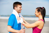 Couple in sports clothing — Stock Photo