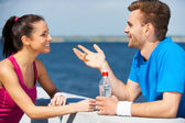 Couple in sports clothing talking — Stock Photo