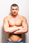 Strong and confident shirtless man — Stock Photo