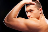 Handsome young muscular man — Stock Photo