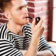 Man smoking pipe. — Stock Photo #46902363