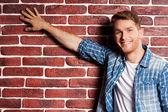 Man touching a brick wall — Foto de Stock