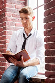 Man writing in note pad — Stock Photo