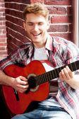 Man playing guitar and singing — Stock Photo