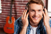 Man adjusting his headphones — Stock Photo