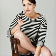 Woman in striped clothing holding pipe — Stock Photo #46976209