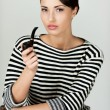 Woman in striped clothing smoking pipe — Stock Photo #46976237