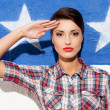 Woman posing against American flag — Stock Photo #46976461