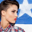 Woman standing against American flag — Stock Photo