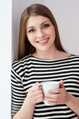 Woman holding cup — Stock Photo