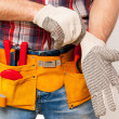 Handyman with tool belt — Stock Photo