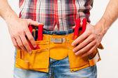 Handyman with tool belt — Stock Photo