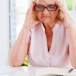 Frustrated senior woman — Stock Photo