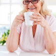 Senior woman holding a cup — Stock Photo #47322987
