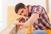 Handyman working with wood in workshop — Stock Photo