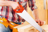 Man sawing. — Stock Photo