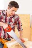Handyman using saw. — Stock Photo