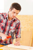 Handyman hammering nail — Stock Photo