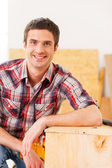 Handyman relaxing after work. — Stock Photo