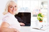Senior woman working on laptop — Stock Photo