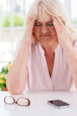 Depressed senior woman — Stock Photo