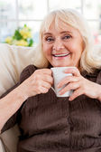 Senior woman holding cup — Stock Photo