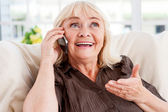 Cheerful senior woman talking on mobile phone — Stock Photo