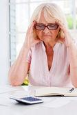 Frustrated senior woman — Stock Photo
