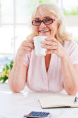 Senior woman holding a cup — Stock Photo