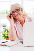 Senior woman adjusting glasses — Stock Photo
