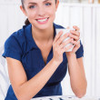 Woman relaxing in cafe. — Stock Photo