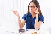 Asian woman talking on the mobile phone — Stock Photo